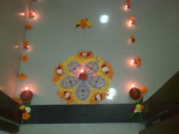 Rangoli using ready made rangoli and flowers