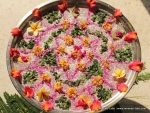 Rangoli on water using Gulal and flowers