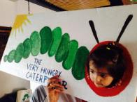 Hand-made photo booth and photo props for The Very Hungry Caterpillar Birthday Party