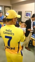 MS Dhoni with his baby Ziva when she made her dressing room debut
