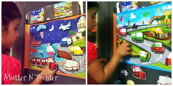 Toddzzle Review: Double sided magnetic mat with night scene (left) and day scene (right)